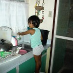 Marilou washing dishes
